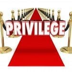 red carpet with word privilege written above it